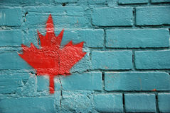 Maple Leaf Graffiti, Toronto, Canada. A bright red maple leaf forms an alternative flag on a wall in Toronto, Canada Stock Image