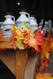 Maple leaf  and maple syrup bottles Royalty Free Stock Images