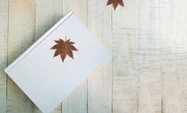 Maple leaf on the white book Stock Photo