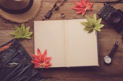Maple leaf on wooden background at summer and notebook for your Royalty Free Stock Photography