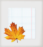 Maple leaf and writing-book Royalty Free Stock Image