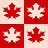 Maple leaves on checkered background - Seamless knitting pattern Stock Photos