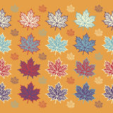 Maple leaves on orange background. Vector seamless pattern for your design project Royalty Free Stock Image