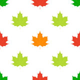Maple leaves seamless pattern. Orange, green, yellow leaf. Flat style Stock Images