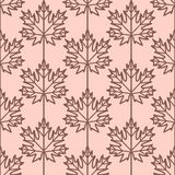 Maple leaves seamless vector pattern. Vintage style and colors (light orange-red). Royalty Free Stock Photo