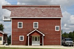 Maple Park Barn House. This is a late Summer picture of a barn that has been converted to a house located in Maple Park, Illinois in Kane County. This picture of royalty free stock photo