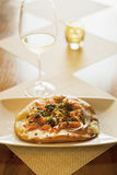 Maple-smoked salmon pizza and glass of wine Royalty Free Stock Photo
