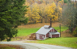 Maple sugar house, Reading, Vermont, USA. Autumn in New England, also called Indian summer. Maple sugar house between trees with fall foliage at the countryside stock images