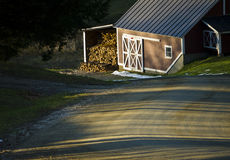 Maple Sugar House at Sunset. Firewood stacked and ready for the winter maple sugaring season at this Vermont Sugar House Royalty Free Stock Images