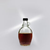 Maple Syrup. A bottle of maple syrup on display against a white background royalty free stock image