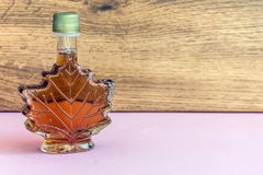 Maple syrup in a bottle maple leaf shape. Suovenir from Canada. Maple syrup Royalty Free Stock Photo