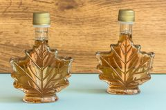 Maple syrup in a bottle maple leaf shape. Suovenir from Canada. Maple syrup Royalty Free Stock Images