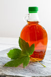 Maple syrup in a bottle on stone plate Stock Photography