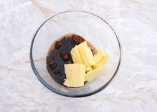 Maple syrup, butter and dark soft sugar in a glass bowl Royalty Free Stock Image