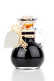 Maple syrup in glass bottle or herbal syrup Royalty Free Stock Images