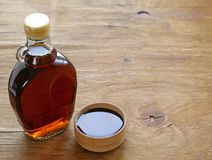 Maple syrup in a glass bottle Royalty Free Stock Photos