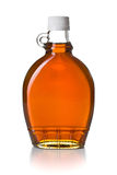 Maple syrup in glass bottle. On white background Royalty Free Stock Images