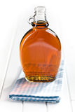 Maple syrup in glass bottle Stock Image