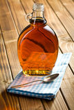 Maple syrup in glass bottle royalty free stock photography