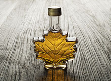 Maple syrup. In glass bottle on wooden table Stock Photo