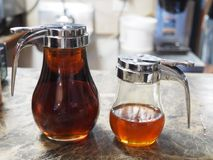 Sweet tooth. Maple syrup and honey closeup Stock Image