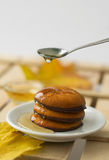 Maple syrup honey and yellow maple leaf and biscuits. On wooden table, autumn canadian sweets Stock Image