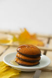 Maple syrup honey and yellow maple leaf and biscuits Stock Photography