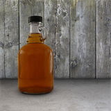 Maple Syrup. Jug of maple syrup in front of a weathered wood wall Royalty Free Stock Photos