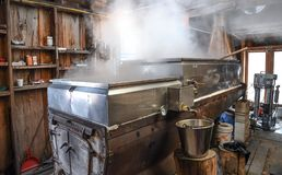 A maple sap evaporator and boiler in a New Hampshire sugar shack. Maple syrup is made from pure maple sap. The traditional method is to boil the sap in an Royalty Free Stock Image