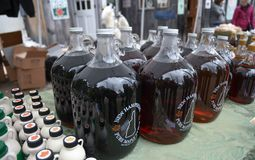 Bottles of fresh maple syrup for sale at Ben`s Sugar Shack in Temple, N.H., USA, March 24, 2018. Maple syrup is made from pure maple sap. The traditional method Stock Image