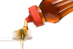 Maple Syrup Pouring on to a Tooth Brush Royalty Free Stock Photos