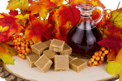 Maple syrup. Presentation of maple syrup and sugar cream fudge on wooden plate Stock Photography