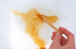 Maple taffy on snow Royalty Free Stock Photo
