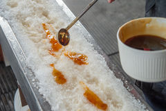 Maple taffy on snow. During sugar shack period. In Quebec, Canada Royalty Free Stock Photography