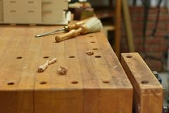 Maple Workbench. Top, vise, dust brush, and paring chisel Royalty Free Stock Photos