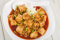 Mapo Tofu. Tofu and minced pork cooked with chili bean paste, fermented black beans, chili oil and Szechuan peppers, garnished with spring onions. Served with Stock Images