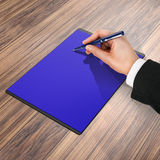 Mapp med papper och pennan, affärsidé Arkivbild