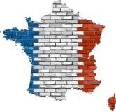 Mappa della Francia su un muro di mattoni Fotografia Stock Libera da Diritti