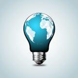 Mappa di mondo, atlante di mondo nella lampadina del tungsteno Immagini Stock Libere da Diritti