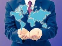 Mappa di mondo della tenuta dell'uomo d'affari Immagine Stock Libera da Diritti