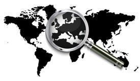 Mappa di mondo sotto la lente d'ingrandimento Fotografie Stock