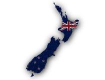 Mappa e bandiera della Nuova Zelanda sui semi di papavero Immagine Stock Libera da Diritti
