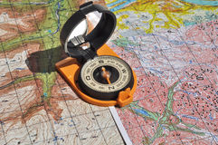 Maps and compass. Royalty Free Stock Photo