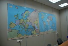Maps in the office. Europe and world map on the wall in the office royalty free stock photo