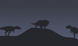 mapusaurus and triceratops dinosaur scenery Royalty Free Stock Image