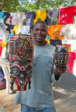 Maputo Staurday's market. MAPUTO, MOZAMBIQUE – APRIL 29: Unidentified man selling traditional african masks on the market in Maputo, Mozambique on April 29 Royalty Free Stock Image