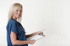mapy gospodarstwa pielęgniarka nad white, Obraz Royalty Free