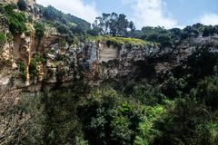 The Maqluba Crater in Malta. The Mysterious Crater and forestation known as il-Maqluba in Malta Stock Photo