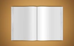 Maqueta de un libro abierto en fondo beige Imagen de archivo libre de regalías