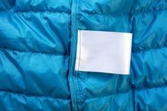 Maqueta en blanco de las instrucciones de cuidado del lavadero de la etiqueta del paño Imágenes de archivo libres de regalías
